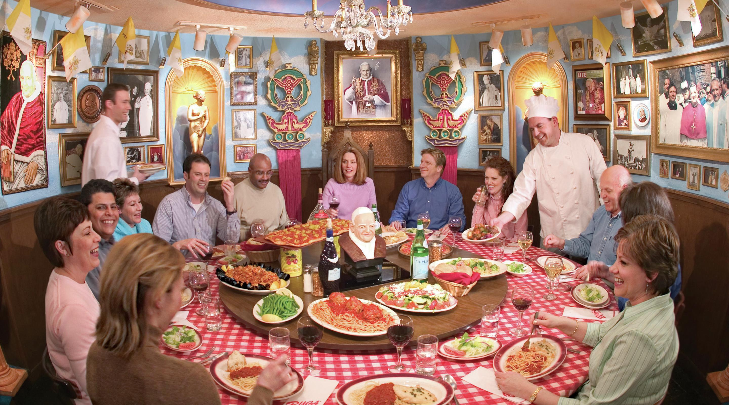 This is an image of a group eating at the Pope Room in Buca di Beppo.